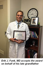 Erik J. Funk, MD accepts award on his behalf.
